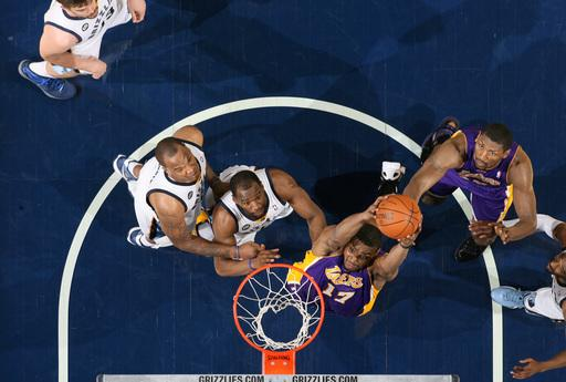 MEMPHIS, TN - MARCH 13: Andrew Bynum #17 of the Los Angeles Lakers rebounds against Sam Young #4 and Marreese Speights #5 of the Memphis Grizzlies on March 13, 2012 at FedExForum in Memphis, Tennessee.  (Photo by Joe Murphy/NBAE via Getty Images)
