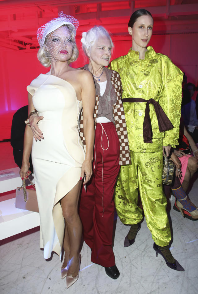 Actress Pamela Anderson, from left, designer Vivienne Westwood and model Anna Cleveland pose for photographers prior to the Vivienne Westwood Ready To Wear Spring-Summer 2020 collection, unveiled during the fashion week, in Paris, Saturday, Sept. 28, 2019. (Photo by Vianney Le Caer/Invision/AP)