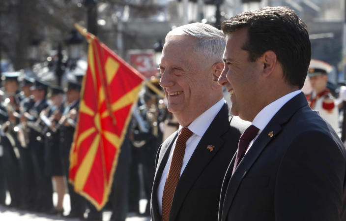 U.S. Defense Secretary James Mattis, center, is welcomed by Macedonian Prime Minister Zoran Zaev, right, upon his arrival at the government building in Skopje, Macedonia, Monday, Sept. 17, 2018. Mattis arrived in Macedonia Monday, condemning Russian efforts to use its money and influence to build opposition to an upcoming vote that could pave the way for the country to join NATO, a move Moscow opposes. (AP Photo/Boris Grdanoski)