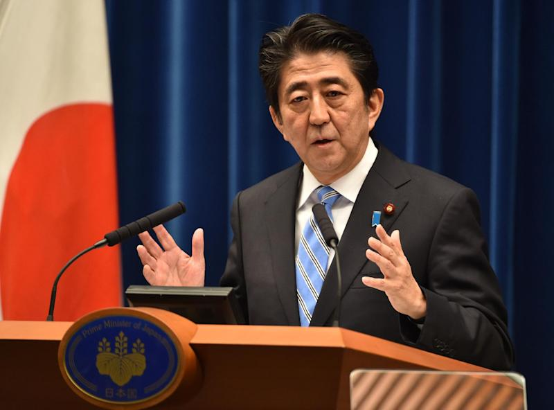 Japan's Prime Minister Shinzo Abe speaks during a press conference at his official residence in Tokyo on November 18, 2014. Abe said he was delaying an expected sales tax rise and dissolving the lower house of parliament (AFP Photo/Kazuhiro Nogi)