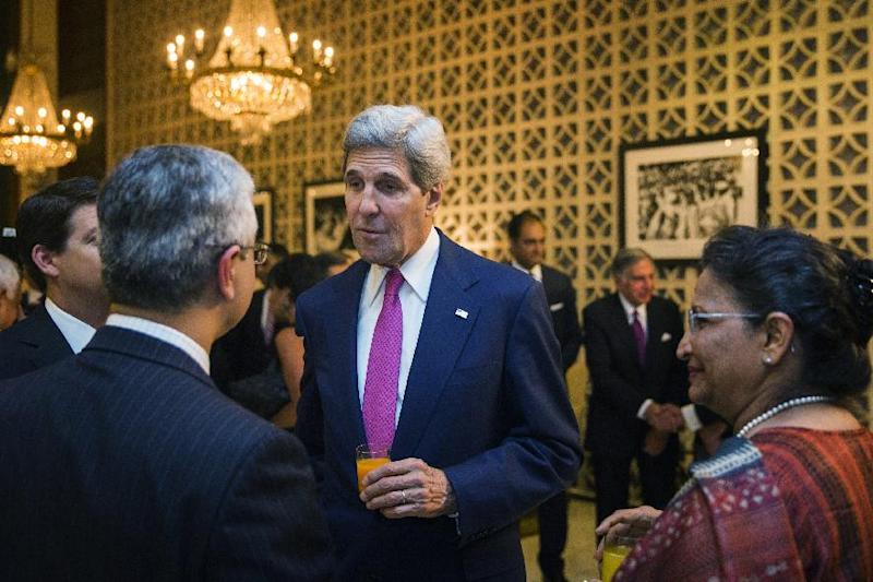 U.S. Secretary of State John Kerry (C) speaks with guests before a dinner at the U.S. Ambassador's residence in New Delhi on July 30, 2014. Kerry flew into India for ice-breaking talks with new Prime Minister Narendra Modi (AFP Photo/Lucas Jackson)
