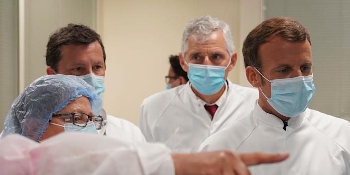 French President Emmanuel Macron visiting a lab at a vaccine unit at the Sanofi Pasteur plant in Marcy-l'Etoile, France, on Tuesday.