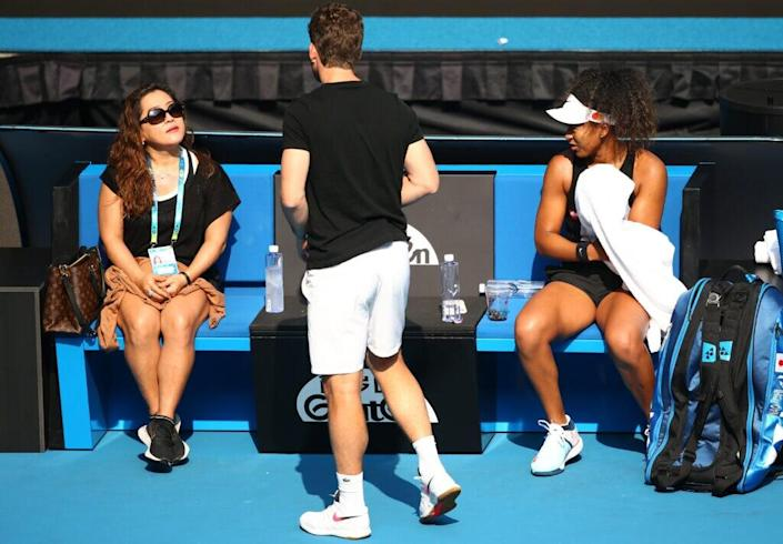 MELBOURNE, AUSTRALIA – JANUARY 19: Naomi Osaka of Japan is seen with her mother Tamaki Osaka and coach Wim Fissette ahead of the 2020 Australian Open at Melbourne Park on January 19, 2020 in Melbourne, Australia. (Photo by Mike Owen/Getty Images)