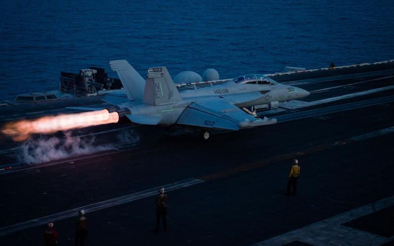This US Navy handout photo obtained April 20, 2017 shows an EA-18G Growler from the Electronic Attack Squadron (VAQ) 136 Guantlets as it takes off from the aircraft carrier USS Carl Vinson (CVN 70) flight deck on April 12, 2017 in the South China Sea - Credit: AFP