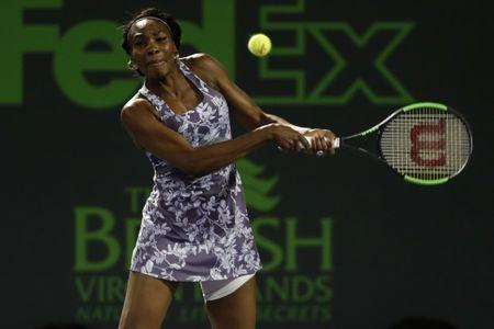 Mar 24, 2017; Miami, FL, USA; Venus Williams of the United States hits a backhand against Beatriz Haddad-Maia of Brazil (not pictured) on day four of the 2017 Miami Open at Brandon Park Tennis Center. Williams won 6-4, 6-3. Mandatory Credit: Geoff Burke-USA TODAY Sports