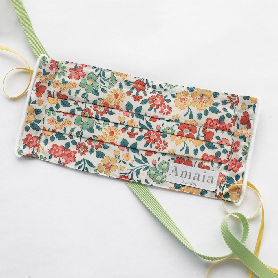 """<p>Stay safe this Christmas with a stylish face mask from Amaia, as worn by Kate Middleton. While the royal mom has been wearing several of their signature floral designs recently, this Annabella style is the perfect nod to the festive season.</p> <p><strong>Buy it! Amaia Annabella face mask, $20; <a href=""""https://www.amaiakids.co.uk/collections/adult-masks/products/adult-reusable-cotton-face-mask-annabelle?variant=33106855100498"""" rel=""""nofollow noopener"""" target=""""_blank"""" data-ylk=""""slk:amaiakids.co.uk"""" class=""""link rapid-noclick-resp"""">amaiakids.co.uk</a></strong></p>"""