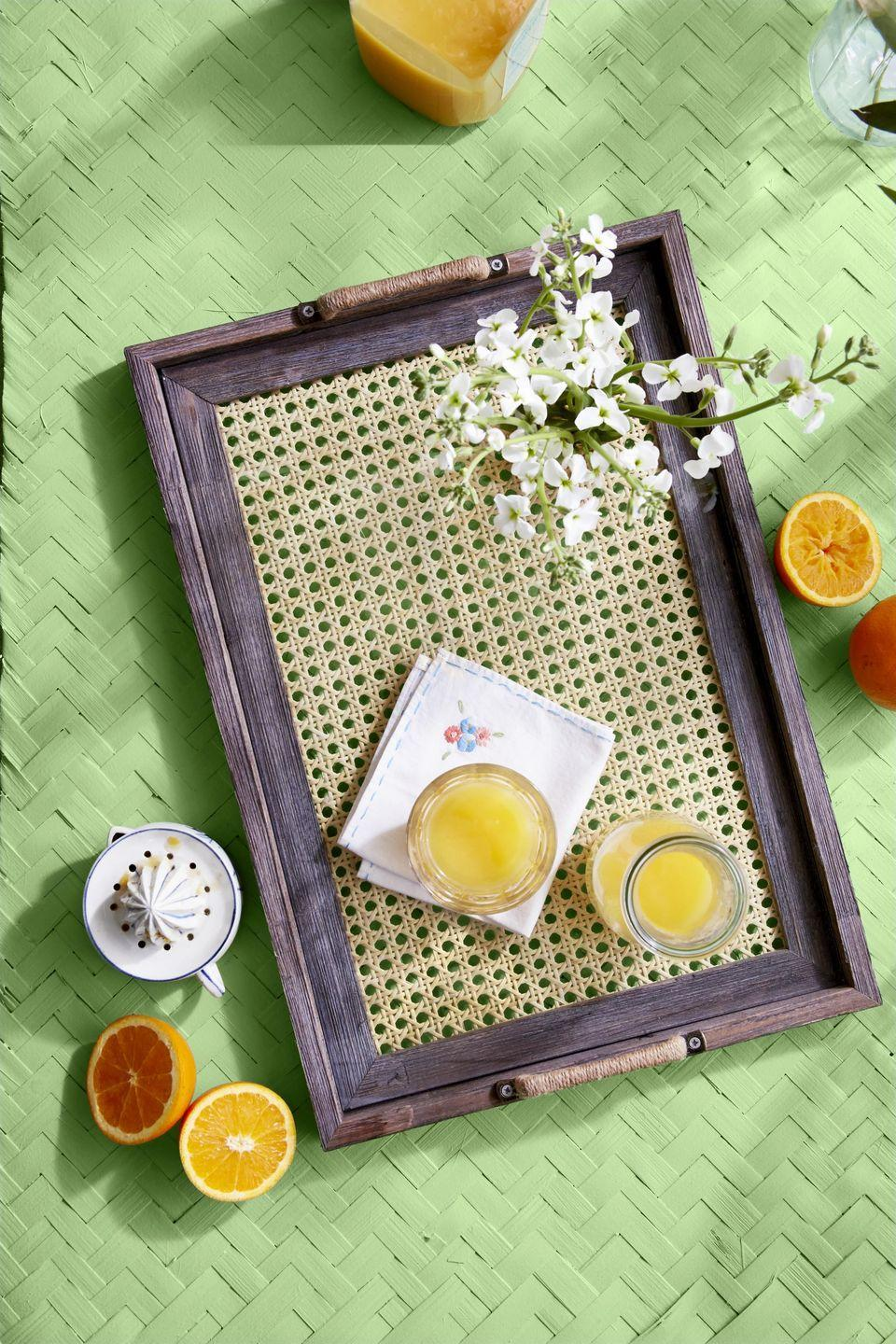 """<p>Breakfast in bed (yes, that should still be a thing) just got a whole lot prettier when served on a DIY tray that's been decked out with cane webbing.<strong><br><br>To make:</strong> Insert a piece of caning that is the same size as the opening of a picture frame (here, a 16-by-20- inch frame by <a href=""""https://www.amazon.com/BarnwoodUSA-Rustic-Farmhouse-Signature-Picture/dp/B01ELNZLPK/ref=sr_1_5"""" rel=""""nofollow noopener"""" target=""""_blank"""" data-ylk=""""slk:Barnwood-USA, $45; amazon.com)"""" class=""""link rapid-noclick-resp"""">Barnwood-USA, $45; <em>amazon.com</em>)</a>. Hold in place with craft glue or glazing points. Attach three-inch cabinet-style handles (wrapped with twine, if desired) to the short ends of the frame. Insert a piece of glass that covers the full opening, if desired.</p>"""