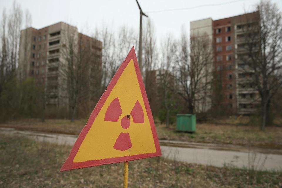 A sign warns of radiation contamination near former apartment buildings in Pripyat, 30 years on from the Chernobyl disaster: Getty Images