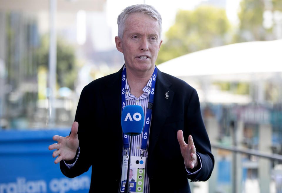 Craig Tiley, CEO of Tennis Australia, addresses the media at Melbourne Park, venue for the Australian Open, in Melbourne, Australia, Friday Feb. 12, 2021. The Australian Open will be allowed to continue but without crowds for at least five days after the Victoria state government imposed a lockdown starting Saturday in response to a COVID-19 outbreak at a quarantine hotel. (Fiona Hamilton/Tennis Australia via AP)