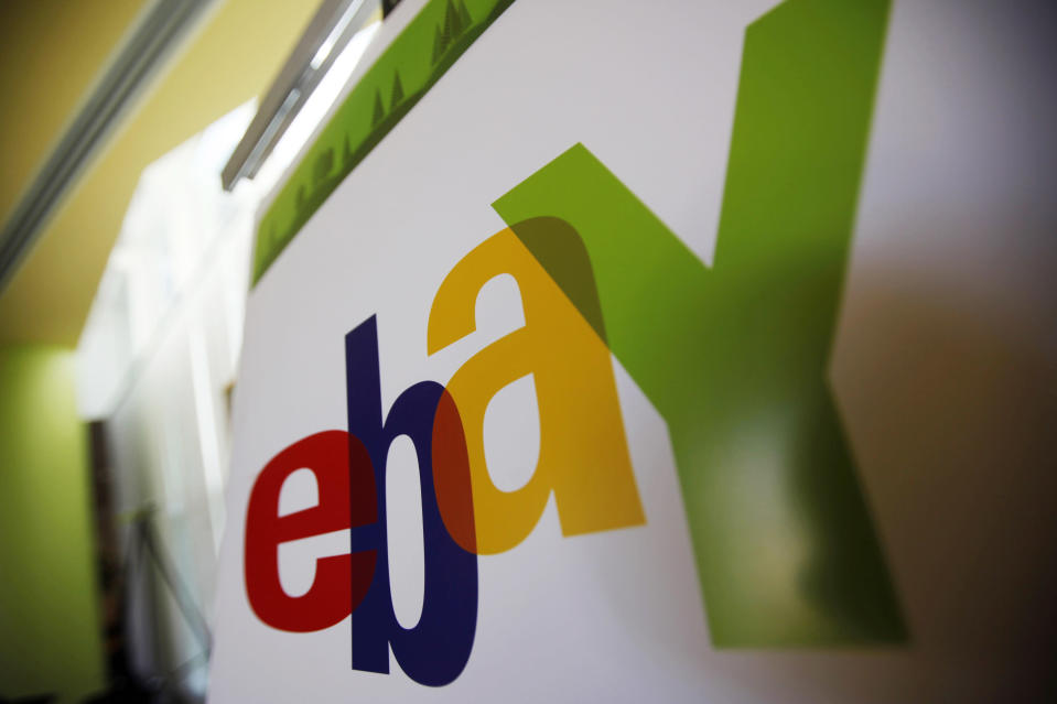 """FILE - In this Feb. 24, 2010 file photo, an eBay logo is seen at their offices in San Jose, Calif. A Massachusetts couple subjected to threats and other bizarre harassment from former eBay Inc. employees filed a civil lawsuit against the Silicon Valley giant on Wednesday, July 21, 2021. David and Ina Steiner say in their lawsuit filed in Boston federal court that the company engaged in a conspiracy to """"intimidate, threaten to kill, torture, terrorize, stalk and silence them"""" in order to """"stifle their reporting on eBay."""" (AP Photo/Paul Sakuma, File)"""
