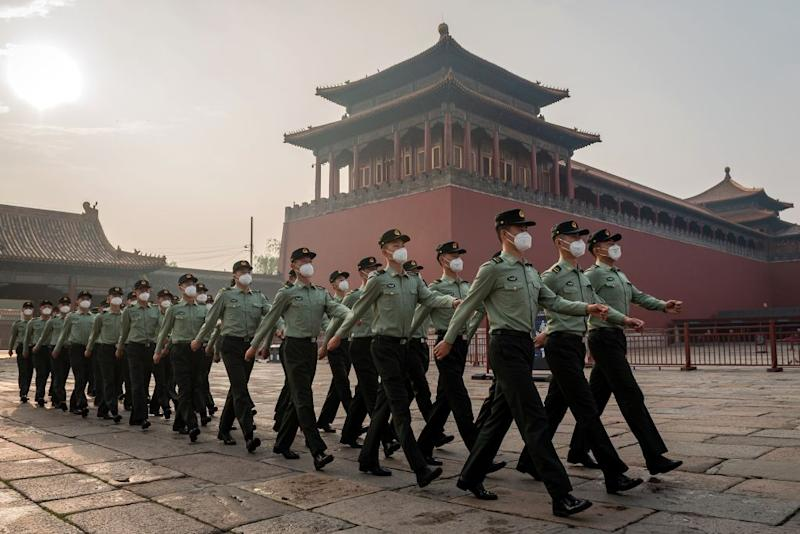 Chinese soldiers march next to the entrance to the Forbidden City during the opening ceremony of the Chinese People's Political Consultative Conference (CPPCC) in Beijing. Source: AFP via Getty