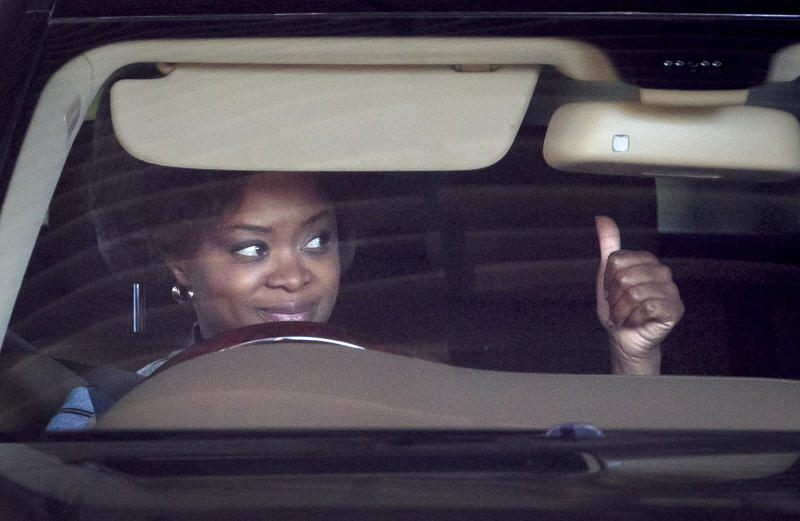 Josina Machel, daughter-in-law of former president Nelson Mandela, gestures to police as she leaves the Mediclinic Heart Hospital where Nelson Mandela is being treated in Pretoria, South Africa Monday, June 17, 2013. In tweets, songs, telephone calls, cards and more, messages of love have come from across South Africa and the world for 94-year-old Nelson Mandela, giving the family comfort and hope as he remains hospitalized in serious condition with a lung infection, his wife Graca Machel said Monday. (AP Photo/Ben Curtis)