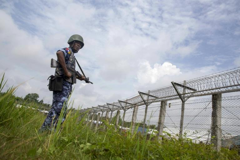 Myanmar border guards patrol the fence in the 'no man's land' between Myanmar and Bangladesh