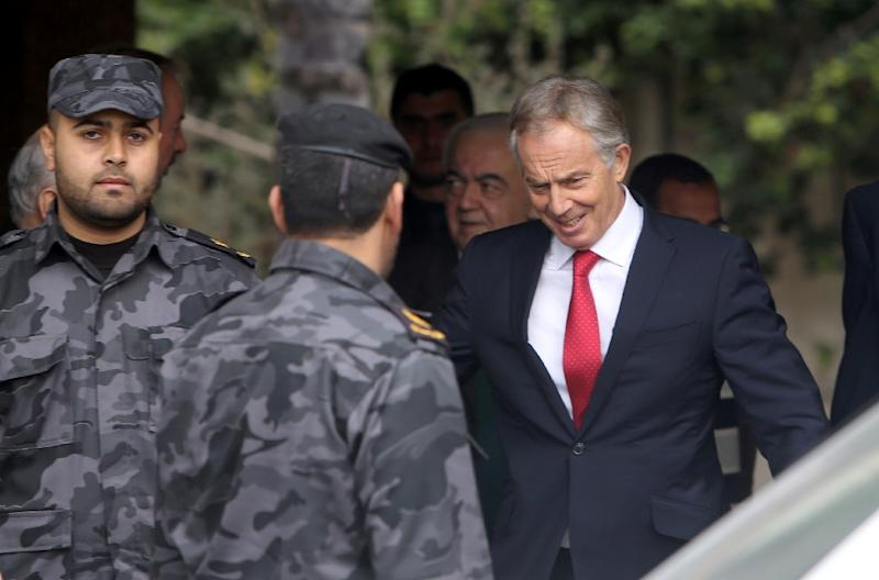 Former prime minister Tony Blair (R) is to take a new role fighting anti-Semitism after stepping down as a Middle East peace envoy (AFP Photo/Mahmud Hams)