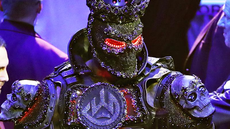 Deontay Wilder pictured arriving in a 20-kilogram costume, has blamed the weight of his outfit for his loss to Tyson Fury.