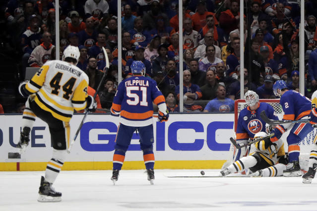 New York Islanders goaltender Robin Lehner, of Sweden, reacts as Pittsburgh Penguins defenseman Erik Gudbranson (44) celebrates his goal during the second period of Game 2 of an NHL hockey first-round playoff series Friday, April 12, 2019, in Uniondale, N.Y. (AP Photo/Julio Cortez)