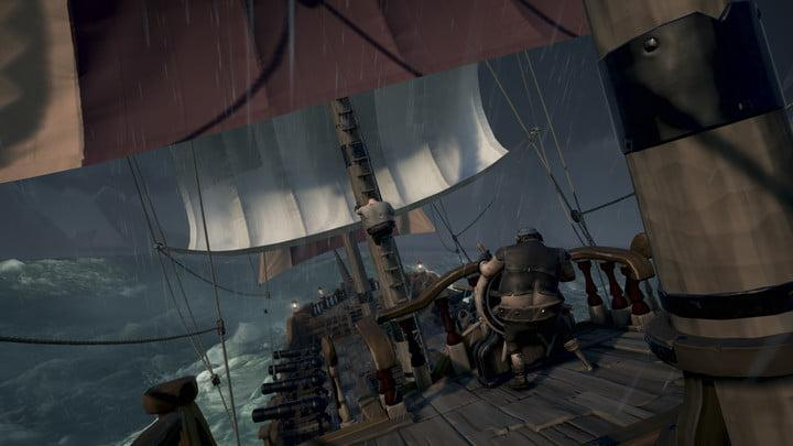 Sea Of Thieves Hands-on Preview | Crewmember piloting ship in storm and swells
