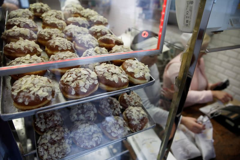 Doughnuts are displayed during traditional Fat Thursday when Poles eat doughnuts marking the last Thursday before the start of Lent, at a bakery in Warsaw