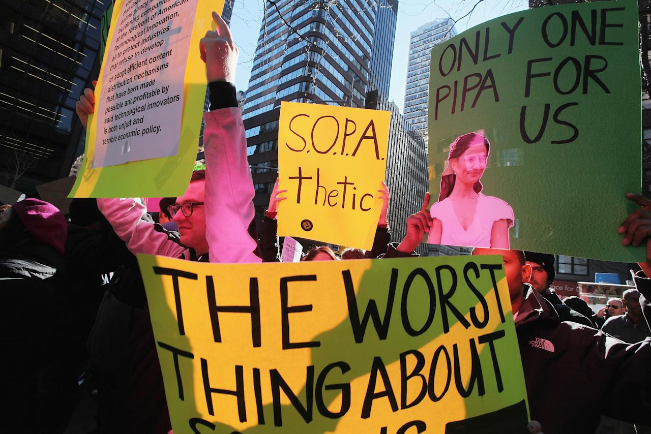 NEW YORK, NY - JANUARY 18:  Protesters demonstrate against the proposed Stop Online Piracy Act (SOPA) and Protect IP Act (PIPA) outside the offices of U.S. Sen. Charles Schumer (D-NY) and U.S. Sen. Kirsten Gillibrand (D-NY) on January 18, 2012 in New York City.  The controversial legislation is aimed at preventing piracy of media but those opposed believe it will support censorship.  (Photo by Mario Tama/Getty Images)
