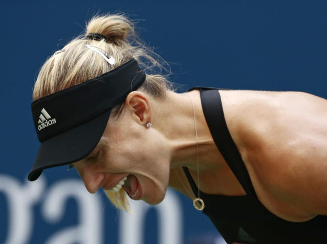 Angelique Kerber, of Germany, reacts against Dominika Cibulkova, of Slovakia, during the third round of the U.S. Open tennis tournament, Saturday, Sept. 1, 2018, in New York. (AP Photo/Andres Kudacki)