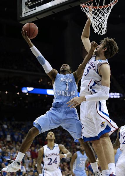 North Carolina guard Dexter Strickland (1) shoots under pressure from Kansas center Jeff Withey (5) during the first half of a third-round game in the NCAA college basketball tournament Sunday, March 24, 2013, in Kansas City, Mo. (AP Photo/Charlie Riedel)