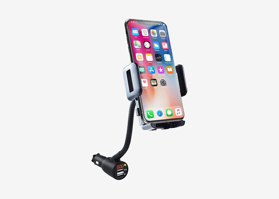 """<p>Whether you're embarking on a solo road trip or have a travel companion who'd rather not dictate directions, a phone mount makes it easier to keep an eye on your route safely. And since doing so can quickly drain your battery, we recommend one that can keep your phone charged while mounted. This one has an adjustable width to fit most cell phones, and a flexible gooseneck to angle it however you prefer.</p> <p><strong>Buy now:</strong> <a href=""""https://amzn.to/2YDwEfm"""" rel=""""nofollow noopener"""" target=""""_blank"""" data-ylk=""""slk:$15, amazon.com"""" class=""""link rapid-noclick-resp"""">$15, amazon.com</a></p>"""