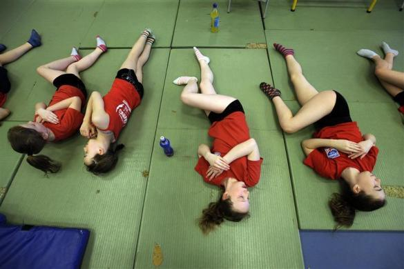 Members of the Crystal Palace diving club stretch during a training session in a dry diving gym in London March 9, 2012.