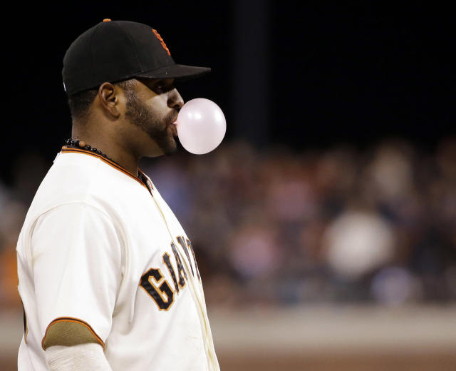 San Francisco Giants' Pablo Sandoval blows bubble gum during the fifth inning of a baseball game against the San Diego Padres on Monday, April 28, 2014, in San Francisco. (AP Photo/Marcio Jose Sanchez)