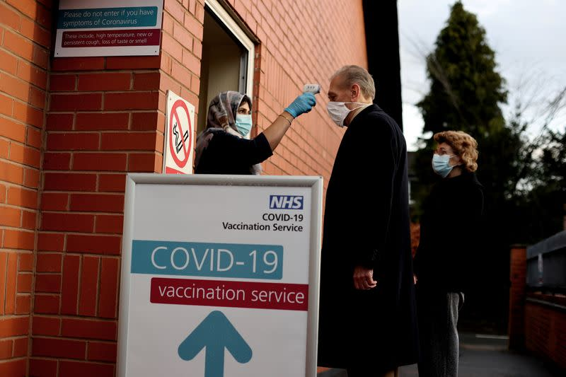 FILE PHOTO: People get injections of Pfizer-BioNTech COVID-19 vaccine in Wolverhampton