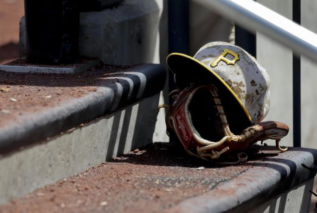 A Pittsburgh Pirates ball cap made with a military camouflage pattern sits on the steps of the dugout of a baseball game, Monday, May 26, 2014, in New York. Players from the Pirates and New York Mets teams wore the camouflage caps in recognition of Memorial Day. (AP Photo/Julie Jacobson)