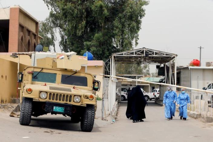 A military vehicle of Iraqi security forces is seen at the main entrance of Ibn Khatib hospital where a fire was sparked by an oxygen tank explosion, in Baghdad