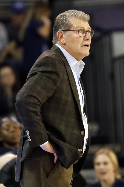 Connecticut head coach Geno Auriemma watches his team against East Carolina during the first half of an NCAA college basketball game, Saturday, Jan. 25, 2020 in Greenville, N.C. (AP Photo/Karl B DeBlaker)
