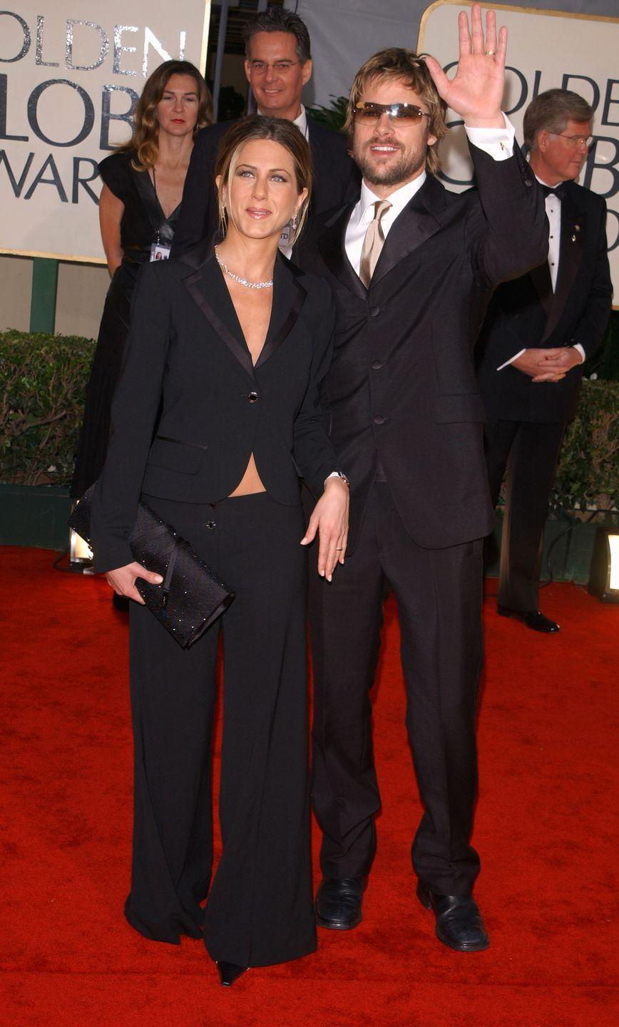 <p>Jen matched her then-boo Brad Pitt in 2001, opting for a wide-leg pantsuit.</p>