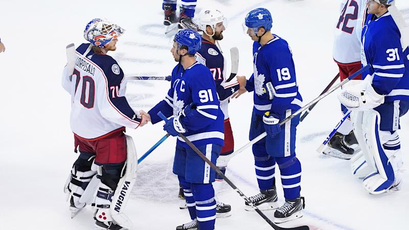 TORONTO, ONTARIO - AUGUST 09: Joonas Korpisalo #70 and Nick Foligno #71 of the Columbus Blue Jackets shake hands with John Tavares #91 and Jason Spezza #19 of the Toronto Maple Leafs after winning 3-0 in Game Five of the Eastern Conference Qualification Round prior to the 2020 NHL Stanley Cup Playoffs at Scotiabank Arena on August 09, 2020 in Toronto, Ontario. (Photo by Andre Ringuette/Freestyle Photo/Getty Images)