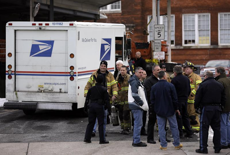 Law enforcement and other emergency personnel gather outside a post office Friday, Jan. 31, 2014, in Rutherford, N.J. White powder was mailed to businesses near the site of Sunday's Super Bowl, prompting an investigation by the FBI and other law enforcement. A federal law enforcement official said one of the envelopes contained baking soda. (AP Photo/Jeff Roberson)