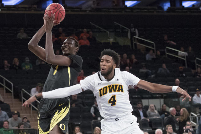 Oregon center Bol Bol (1) goes to the basket against Iowa guard Isaiah Moss during the second half of an NCAA college basketball game in the 2K Empire Classic, Thursday, Nov. 15, 2018, at Madison Square Garden in New York. Iowa won 77-69. (AP Photo/Mary Altaffer)
