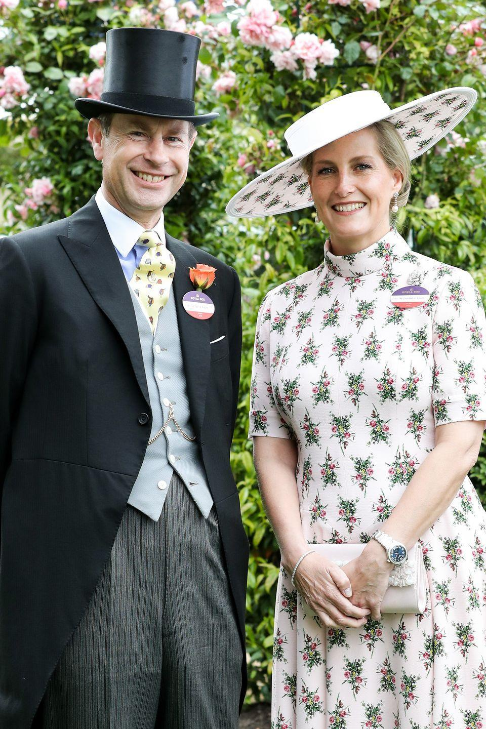 <p>On Opening Day of Royal Ascot, the Countess of Wessex posed for photos with Prince Edward in honor of their upcoming 20th wedding anniversary. For the day at the races, Sophie chose a pale pink dress with a bold floral pattern, and paired it with a matching wide-brimmed hat. </p>