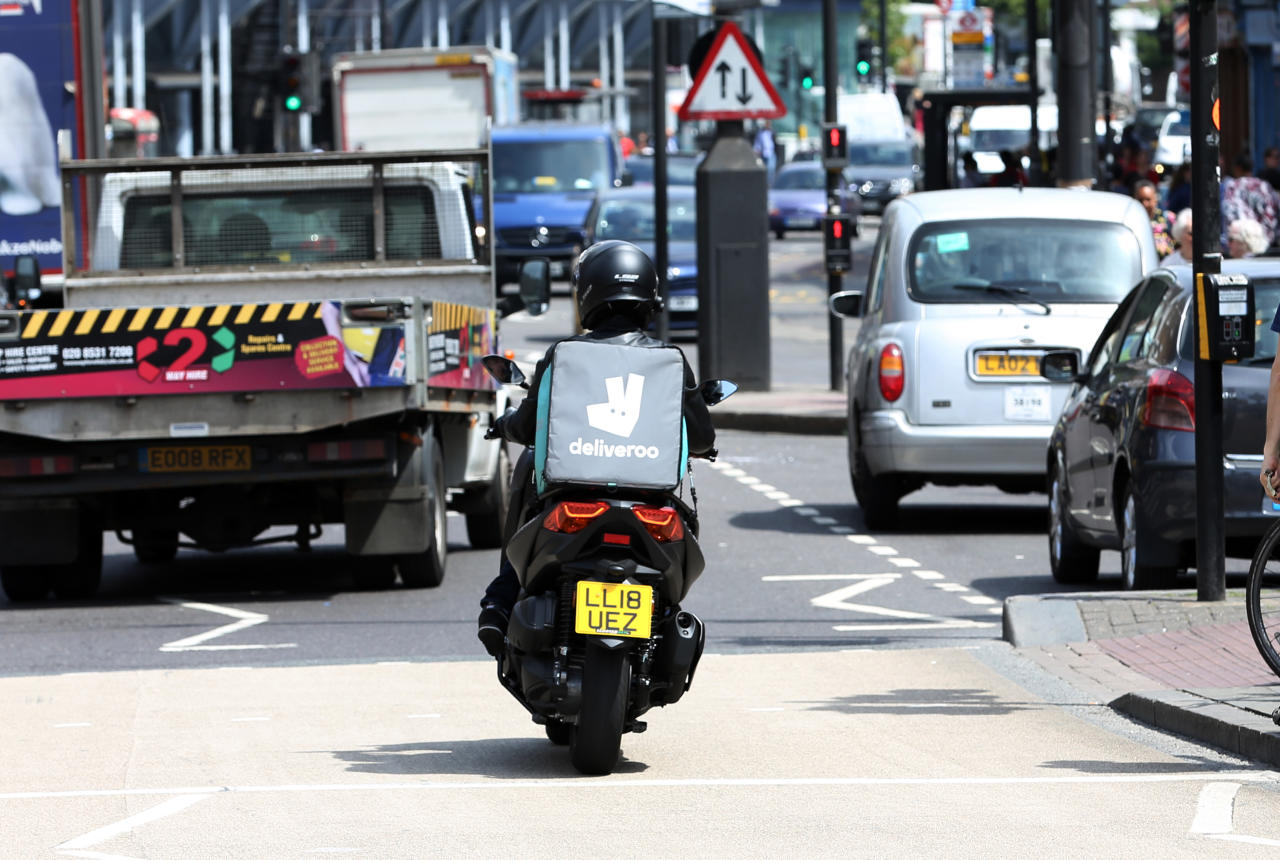 "<p> A Deliveroo driver is seen in traffic in north London, Friday, June 15, 2018. A judge has given a British union permission to mount a legal challenge over the employment status of drivers for the food-delivery service Deliveroo. Last year a tribunal ruled that Deliveroo's moped drivers and cyclists are self-employed. The Independent Workers Union of Great Britain disputes that and says riders are being ""denied basic employment rights"" including a guaranteed minimum wage, holiday pay and collective-bargaining rights. (AP Photo/Robert Stevens) </p>"