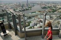 A girl plays with her hair in the wind on the observation point at the tallest building in Yekaterinburg, Russia June 28, 2018. REUTERS/Damir Sagolj