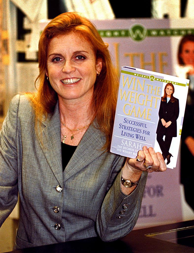 """Sarah Margaret Ferguson, The Duchess Of York, Poses With Her New Book """"Win The Weight Game: Successful Strategies For Living Well"""", Prior To A Book Signing Event In Hollywood, California on January 24, 2000."""