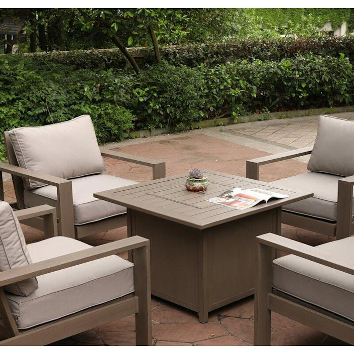 """This is another one of the best fire tables we've come across. Not only can you enjoy the flames, you have a convenient place to set your plate or drink. $1020, AllModern. <a href=""""https://www.wayfair.com/outdoor/pdp/real-flame-austin-steel-wood-burning-fire-pit-jfp10008.html"""" rel=""""nofollow noopener"""" target=""""_blank"""" data-ylk=""""slk:Get it now!"""" class=""""link rapid-noclick-resp"""">Get it now!</a>"""
