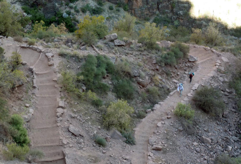 File-This Wednesday, Sept. 29, 2010 file photo shows a switchback on Bright Angel Trail in Grand Canyon National Park, Ariz. About 4.5 million people visit the Grand Canyon every year, but most visit in summer and relatively few venture below the rim. The start of one of the Grand Canyon's most iconic and popular trails has been redesigned and now includes an etched rock sign marking the Bright Angel trailhead. (AP Photo/Carson Walker,File)