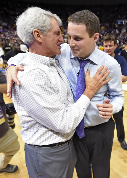 FILE - In this Feb. 23, 2019, file photo, LSU athletic director Joe Alleva, left, hugs and has a word with LSU basketball coach Will Wade after an NCAA college basketball game against Tennessee in Baton Rouge, La. Alleva is stepping down as AD and will have a new role within the school's athletic department. The school announced Wednesday, April 17, that Alleva's new position will be as special assistant to the president for donor relations. He will remain LSU's athletic director until a successor is announced. Alleva has been LSU's athletic director since April 2008. (AP Photo/Bill Feig, File)