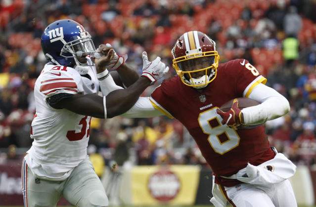 Washington Redskins quarterback Josh Johnson (8) tries to get away from New York Giants defensive back Michael Thomas (31) during the second half of an NFL football game Sunday, Dec. 9, 2018, in Landover, Md. (AP Photo/Patrick Semansky)