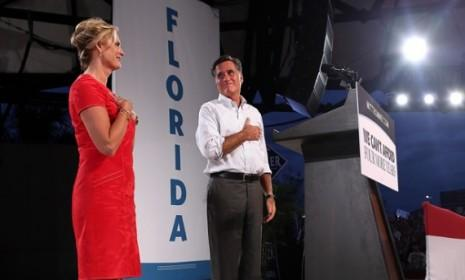 Mitt Romney and his wife Ann campaign in Apopka, Fla., on Oct. 6: According to new polling data, Romney is a mere one point behind Obama in the Sunshine State.