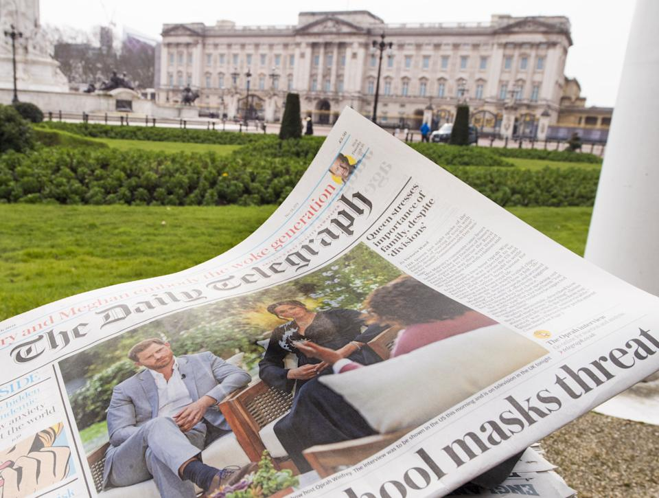 A British newspaper flutters in the wind outside Buckingham Palace in London the day after the Duke and Duchess of Sussex's interview with Oprah Winfrey which is being shown on ITV. Picture date: Monday March 8, 2021. (Photo by Ian West/PA Images via Getty Images) (Photo: Ian West - PA Images via Getty Images)