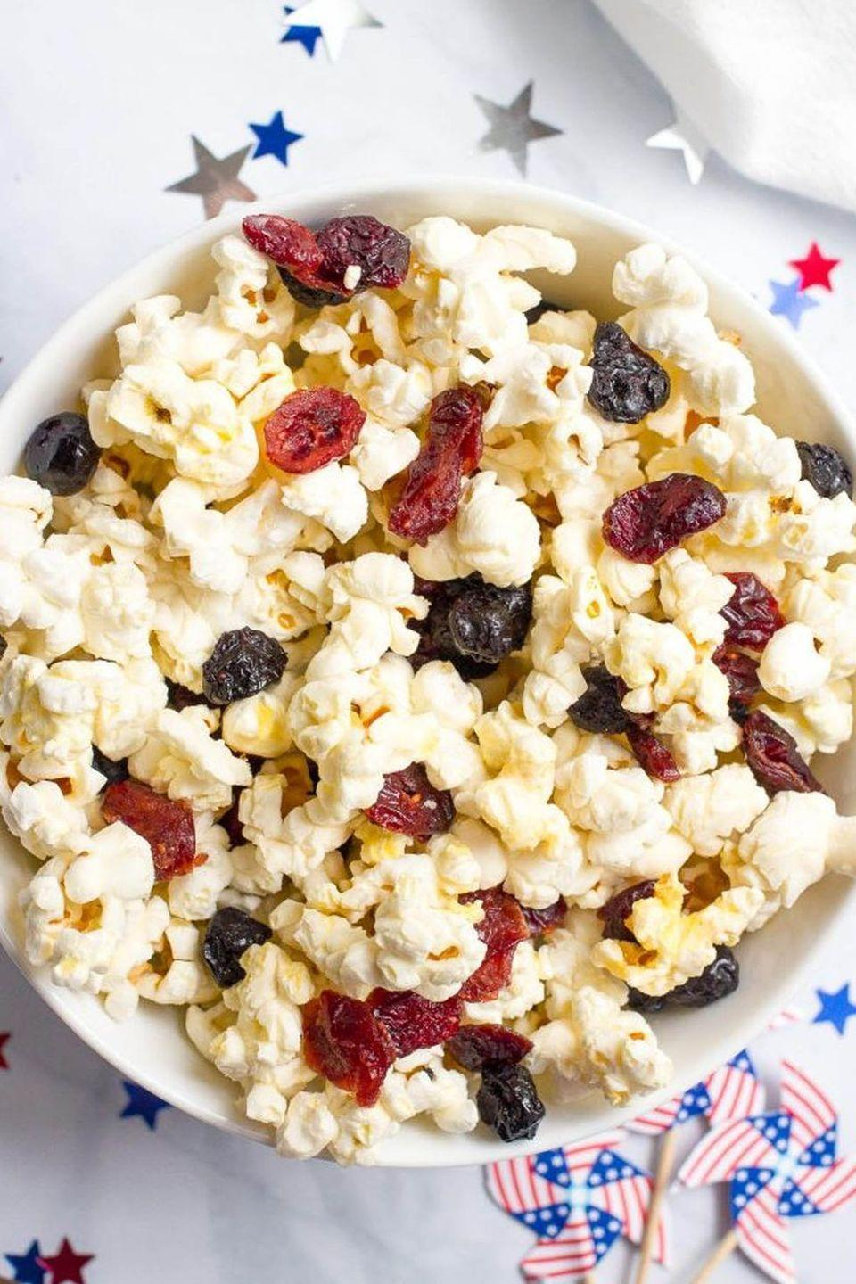 """<p>Fruity popcorn is just the thing to enjoy before a big grilled feast. It's not <em>too</em> filling, but still hits the spot.</p><p><strong>Get the recipe at <a href=""""http://www.familyfoodonthetable.com/3-easy-red-white-blue-july-4th-appetizers/"""" rel=""""nofollow noopener"""" target=""""_blank"""" data-ylk=""""slk:Family Food on the Table"""" class=""""link rapid-noclick-resp"""">Family Food on the Table</a>.</strong></p><p><strong><strong><a class=""""link rapid-noclick-resp"""" href=""""https://go.redirectingat.com?id=74968X1596630&url=https%3A%2F%2Fwww.walmart.com%2Fip%2FThe-Pioneer-Woman-Vintage-Floral-3-Piece-Serving-Bowl-Set%2F115837521&sref=https%3A%2F%2Fwww.thepioneerwoman.com%2Ffood-cooking%2Fmeals-menus%2Fg32157273%2Ffourth-of-july-appetizers%2F"""" rel=""""nofollow noopener"""" target=""""_blank"""" data-ylk=""""slk:SHOP SERVING BOWLS"""">SHOP SERVING BOWLS</a></strong><br></strong></p>"""
