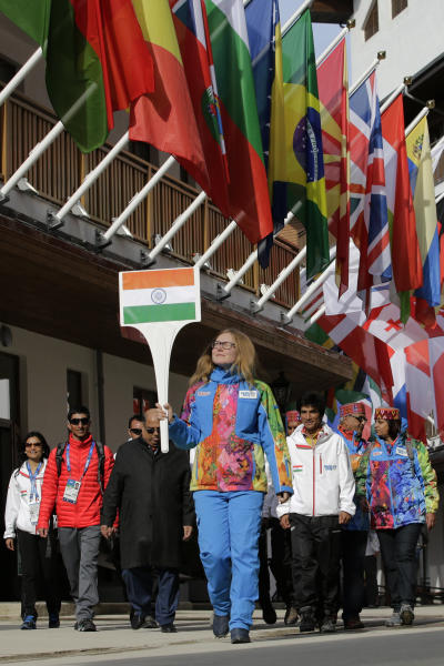 Members of the Indian Olympic team arrive for a welcome ceremony at the Mountain Olympic Village during the 2014 Winter Olympics, Sunday, Feb. 16, 2014, in Krasnaya Polyana, Russia. (AP Photo/Jae C. Hong)