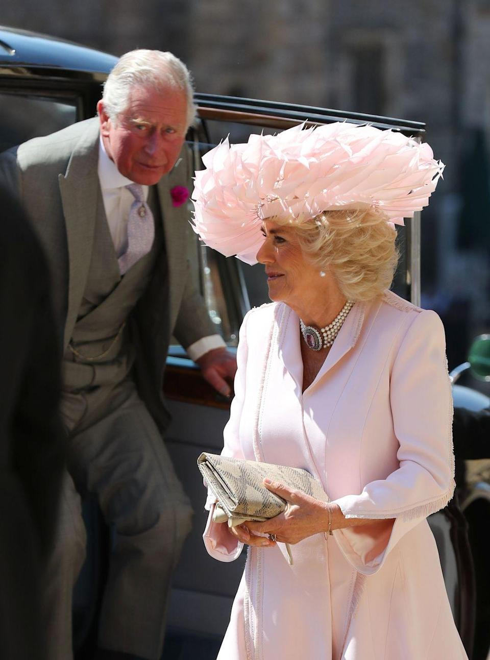 <p>The Duchess of Cornwall's five-strand pearl choker with a huge pink topaz at the center is believed to be a gift from Prince Charles. She wore the piece for the wedding of her stepson, Prince Harry, to Meghan Markle. Camilla is believed to be fond of chokers and wears them regularly.</p>