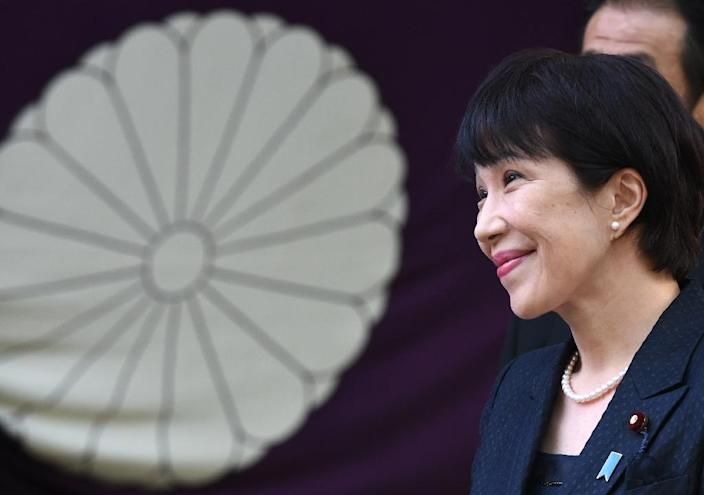 Japanese Internal Affairs and Communication Minister Sanae Takaichi listens to a question after visiting the Yasukuni shrine in Tokyo, on April 23, 2015 (AFP Photo/Toshifumi Kitamura)